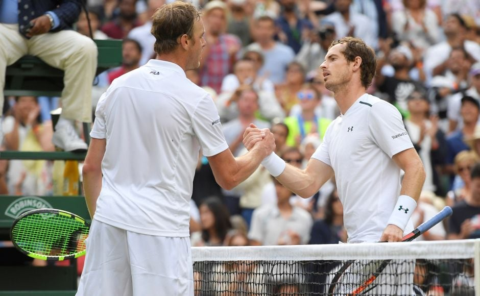 Defending champion Andy Murray was stunned by 24th-seeded Sam Querrey in the Wimbledon quarterfinals on Wednesday. Reuters