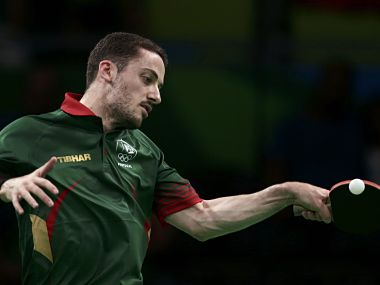2016 Rio Olympics - Table Tennis - Men's Team - Round 1 - Riocentro - Pavilion 3 - Rio de Janeiro, Brazil - 13/08/2016. Marcos Freitas (POR) of Portugal plays against Stefan Fegerl (AUT) of Austria. REUTERS/Alkis Konstantinidis FOR EDITORIAL USE ONLY. NOT FOR SALE FOR MARKETING OR ADVERTISING CAMPAIGNS. - RTX2KL5H
