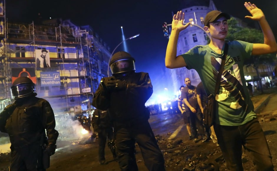 As clashes between protects and authorities escalated, German police arrested hundreds of protesters . Reuters