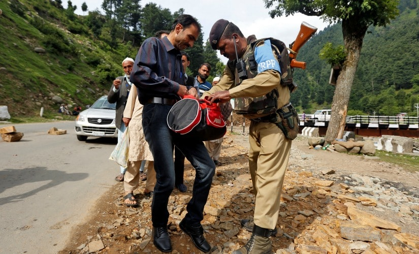 An Indian security force personnel conducts a security check for pilgrims near the Amarnath cave. Reuters