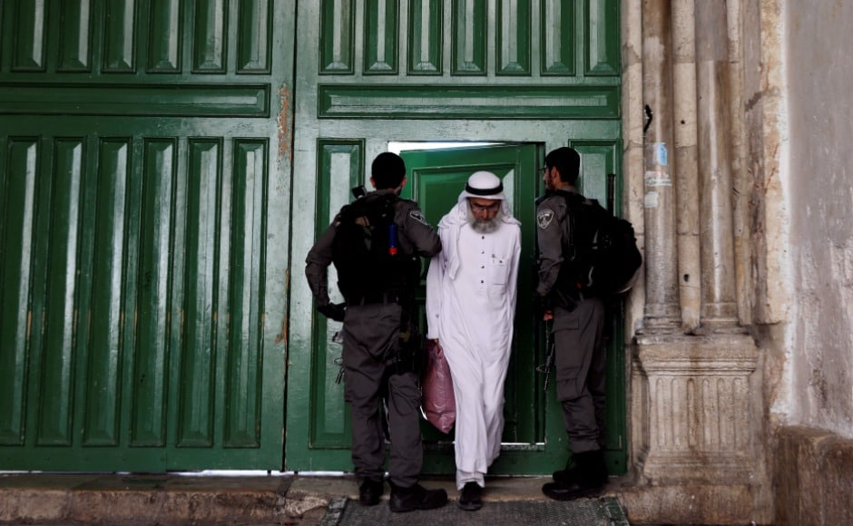 A Muslim man walks out from the compound known to Muslims as Noble Sanctuary and to Jews as Temple Mount, in Jerusalem's Old City. Three Arab-Israeli gunmen shot dead two Israeli policemen near the holy site. The gunmen were then killed by security forces, police said. Reuters