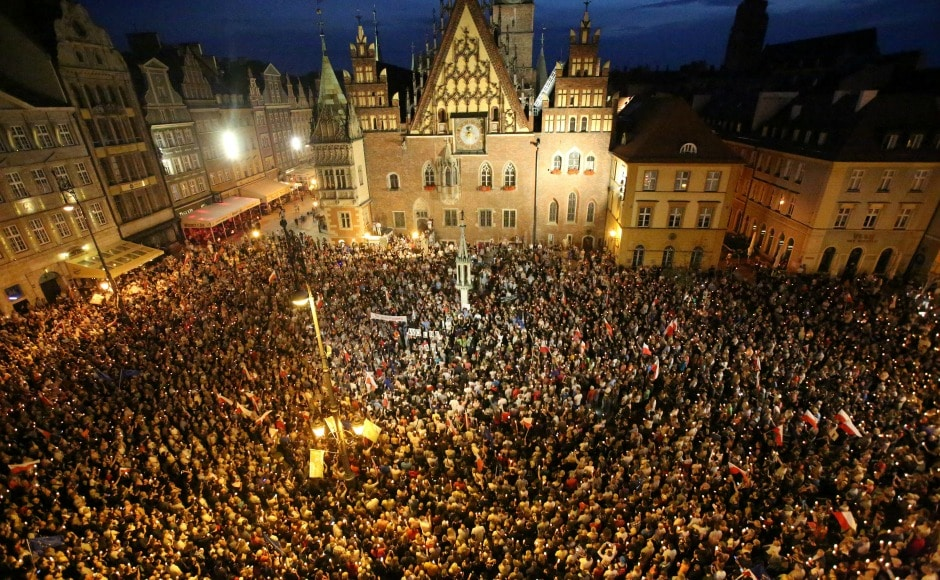 Thousands of people are protesting across Poland against government's plan to put the judicial system under its political control. AP