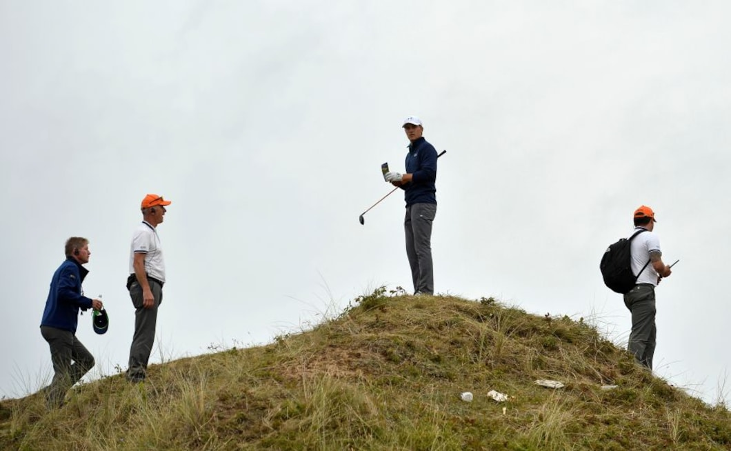Jordan Spieth after landing in the rough off the 13th tee during the final round. He was forced to take a penalty stroke after deeming the ball unplayable and, after a lengthy series of deliberations, he scrambled to make a creditable bogey out of the par-four hole. Reuters