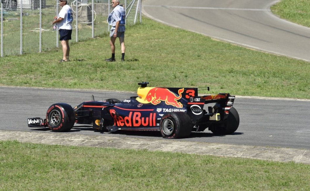 Daniel Ricciardo's race was over after the contact on Turn 2, bringing the safety car out for a few laps as his car was towed off the track. AP