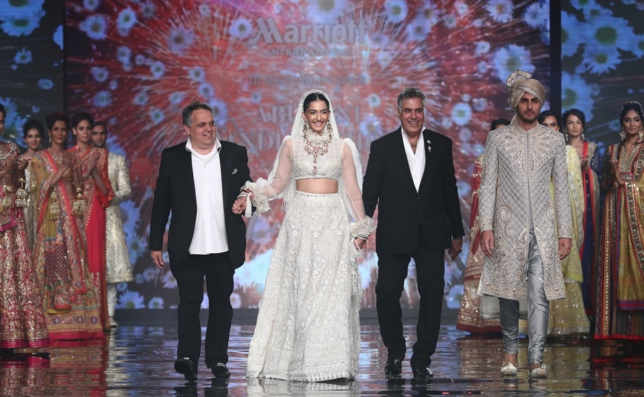Sonam Kapoorwalks the ramp with the designers - artists behind the spectacular collection.
