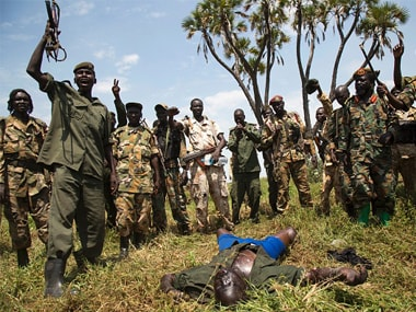 Soldiers of the Sudan People Liberation Army (SPLA) celebrate their victory over the body of a dead rebel soldier in South Sudan. Getty Images
