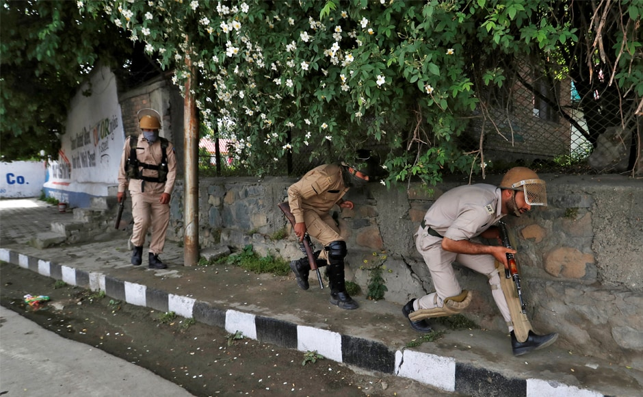 Police officers take cover from stone pelters during disturbances in Srinagar. The police is drawing a new generation into a decades-old struggle for 'azaadi', or independence, for India's only Muslim-majority region, which is also claimed by neighbouring Pakistan. Reuters