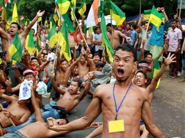 Indigenous People Front of Tripura (IPFT) and other tribal wings protest in national highway no 44  in Khamtingbari area to demand a separate state- Tipraland, in Baramura, Agartala on Monday. PTI