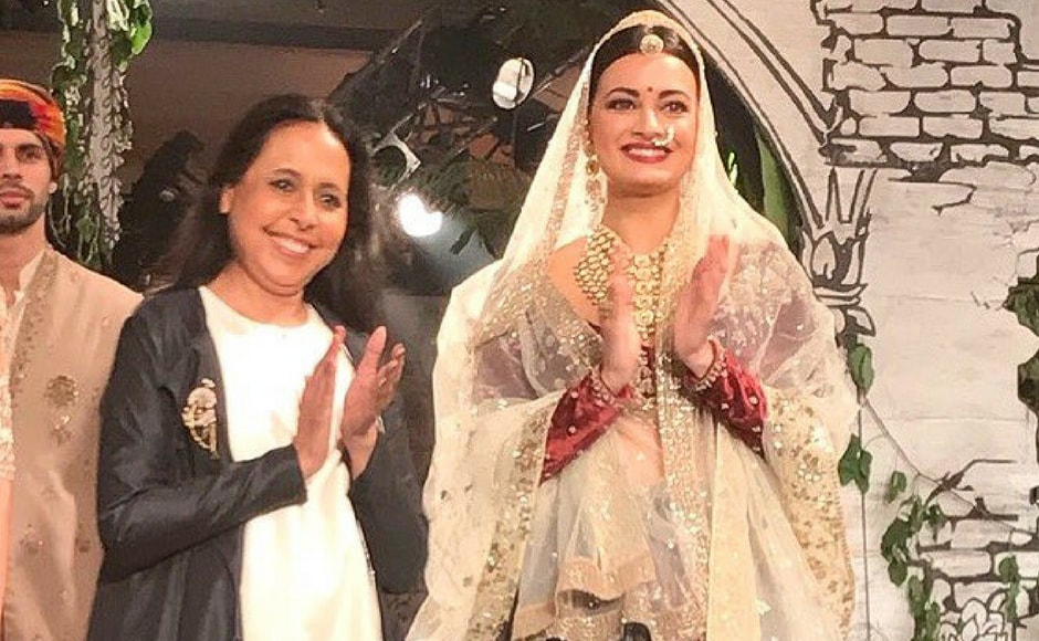 Dia Mirza closed Bajirao Mastani designer Anju Modi's fashion show on Day 4 of India Couture Week. The actress walked the environmentally friendly runway in a traditional bridal outfit. Image via FDCI/Twitter.
