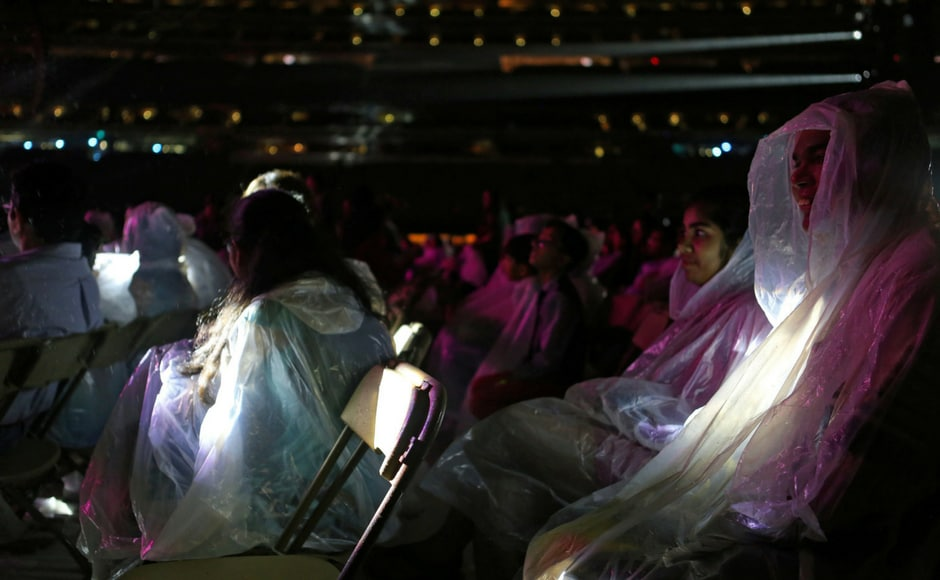 Concertgoers wear ponchos to protect against the rain while attending the International Indian Film Academy Rocks show at MetLife Stadium in East Rutherford, New Jersey, U.S. (Reuters)