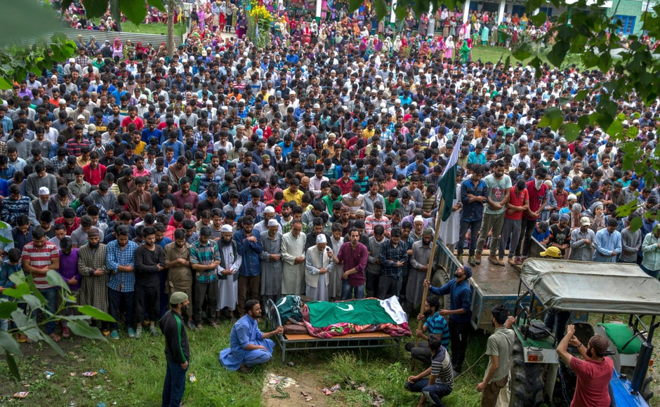 Kashmiri villagers offer prayers by the body of Showkat Lohar, a local militant, during his funeral in Arwani, about 55 kilometers south of Srinagar on Tuesday. AP