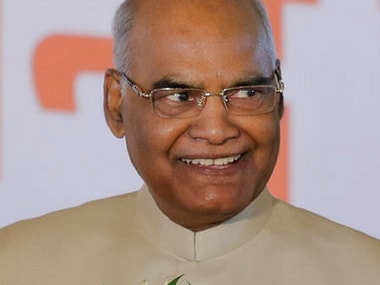 Ram Nath Kovind, smiles as he receives greetings from well wishers after being elected in New Delhi. AP