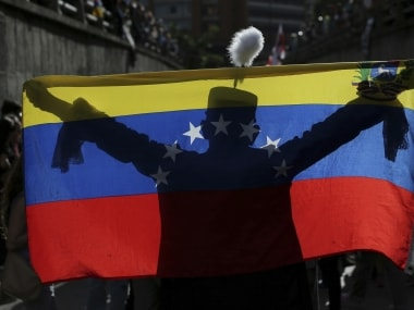 Opposition, government vie for votes as polarised Venezuela goes to polls today