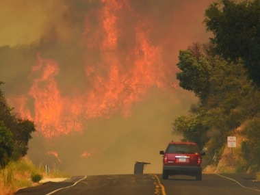 Wildfires barreled across the baking landscape of the western U.S. and Canada. AP