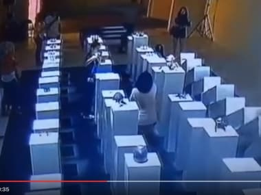 Woman causes domino effect while taking selfie. Image courtesy: YouTube screengrab