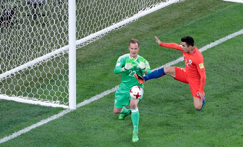 Chile's Edson Raul Puch Cortez and Marc-Andre Ter Stegen challenge for the ball during the Confederations Cup final. AP