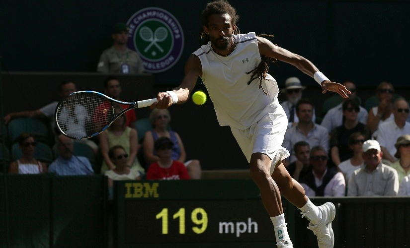 Germany's Dustin Brown returns to Britain's Andy Murray during their Men's Singles Match on day three at the Wimbledon Tennis Championships in London Wednesday, July 5, 2017. (AP Photo/Tim Ireland)