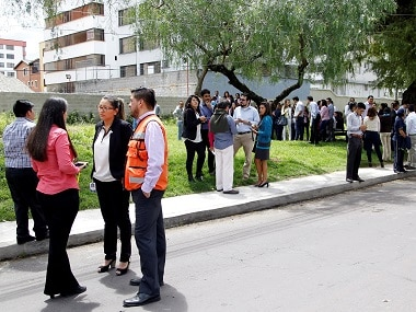 People gather on the streets minutes after a tremor was felt in Quito. Reuters