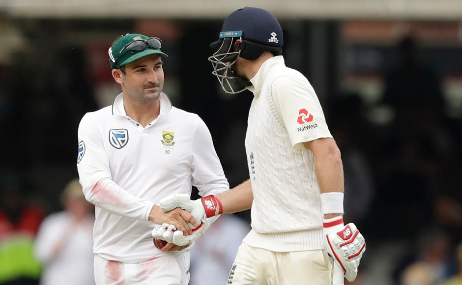 England captain Joe Root(R) shakes hands with South Africa captain Dean Elgar as he walks off at the end of the day's play. AP