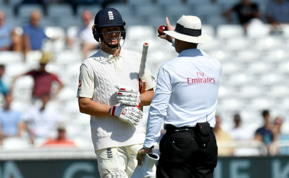 England's Gary Ballance leaves the field after being given out on review for 4 runs. His wicket meant that England were 28/2 in the 12th over of the innings and in some early discomfort. AFP