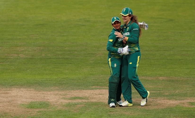 South Africa's Laura Wolvaardt (right) celebrates catching England's Heather Knight. Reuters