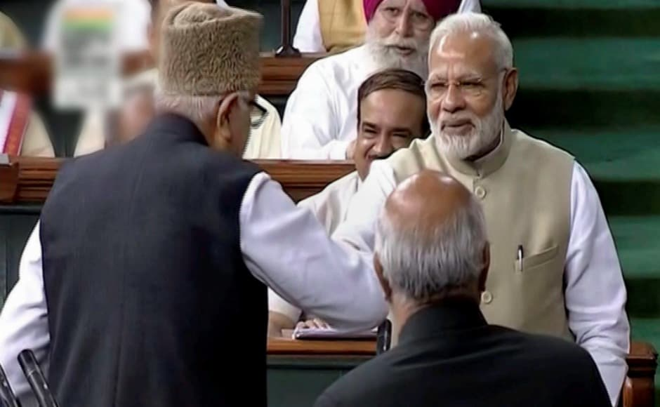 Prime Minister Narendra Modi greets JKNC President Farooq Abdullah after he was sworn-in as a member of the Lok Sabha in New Delhi on Monday. PTI