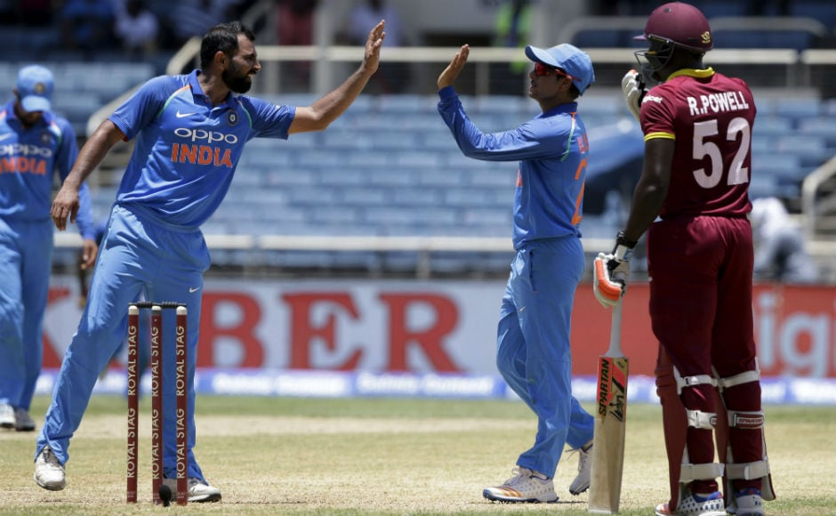 India's Mohammed Shami congratulates teammate Kuldeep Yadav for taking the catch to dismiss Windies' Ashley Nurse during the 5th ODI of the series at Sabina Park in Kingston, Jamaica. AP