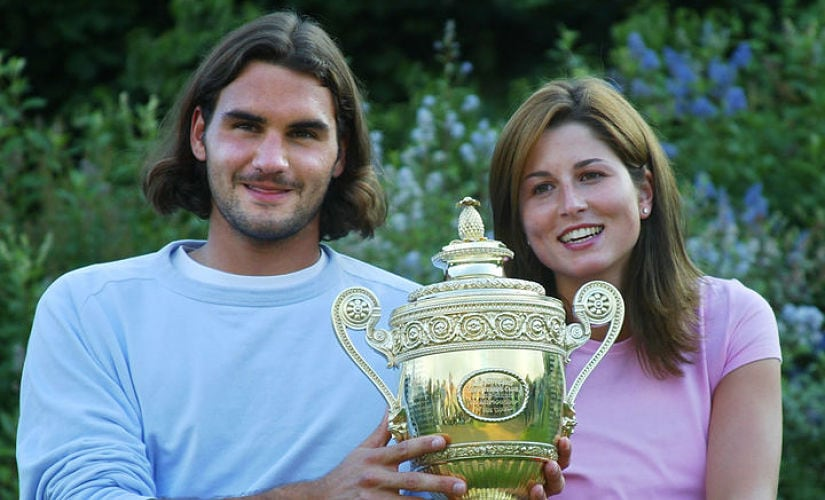 Roger Federer of Switzerland sits with his girl friend Mirka Vavrinec after he won his Men's Final match against Mark Philippoussis of Australia at the Wimbledon Tennis Championships 06 July, 2003 in Wimbledon, south London. AFP PHOTO/Thomas COEX / AFP PHOTO / THOMAS COEX