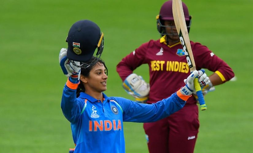 Smriti Mandhana raising her bat after the match-winning century against the West indies. Twitter/@BCCIwomen