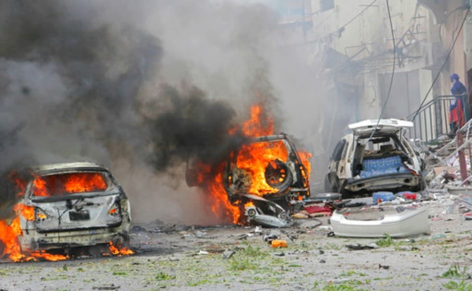 A car bomb attack near a police station in Somalia's capital killed at least five people and wounded at least 13 others. Most of the victims are civilians. AP