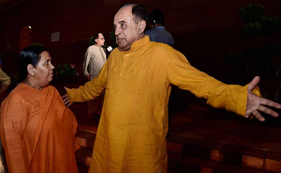"""Subramanian Swamy, a bitter critic of GST-Network – the IT provider for the new indirect tax regime — was also present at the launch event. He had called the GSTN a """"a shady organisation"""" and said it was a """"grave security"""" issue. In this image Swamy is seen in conversation with Minister of Water Resources Uma Bharti. PTI"""