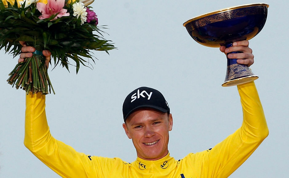 Britain's Chris Froome, wearing the overall leader's yellow jersey, celebrates on the podium after Stage 21 of the Tour de France. Froome won his fourth and most challenging Tour de France title on Sunday. AP