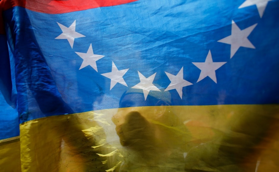 People in Venezuela are facing sky-high inflation and a scarcity of food and medicines; confrontations between protesters and the National Bolivarian Guard have led to 90 fatalities so far with over 1,500 injured. AP