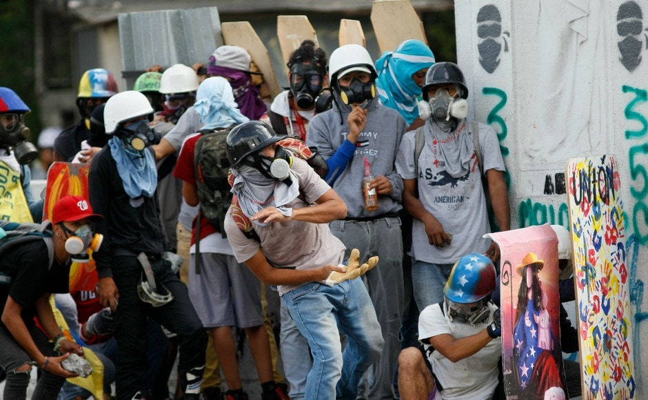 The protesters use the shields to form walls, or even beat on them in unison, as Roman soldiers and Norsemen used to do while going into battle.For over three months, tear gas, rubber bullets, rocks and bombs have been exchanged between protesters and security forces in hotspots around the OPEC nation. AP