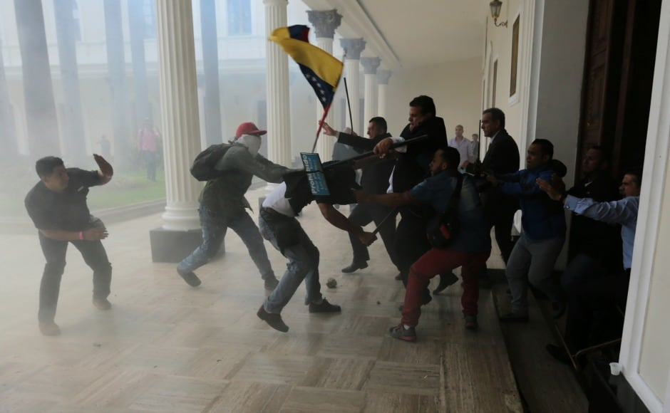 Opposition lawmakers brawled with pro-government militias who were trying to force their way into the National Assembly during a special session coinciding with Venezuela's independence day. AP