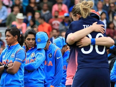 India players stand dejected prior to receiving their runners-up medals after losing the ICC Women's World Cup final match against England, at Lord's, in London. AP