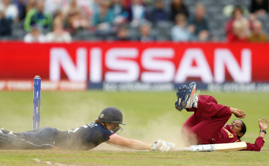 West Indies' Anisa Mohammed attempts to run out England captain Heather Knight. Knight scored a fine 67 and England won the match by 92 runs. Reuters
