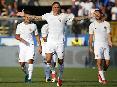 AS Roma's Serbian defender Aleksandar Kolarov celebrates after scoring a goal during the Italian Serie A football match between Atalanta and AS Roma on August 20, 2017 at the Atleti Azzurri d'Italia stadium in Bergamo. / AFP PHOTO / Marco BERTORELLO