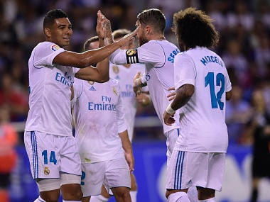 Real Madrid's Brazilian midfielder Casemiro (L) celebrates with teammates after scoring during the Spanish league footbal match RC Deportivo de la Coruna vs Real Madrid CF at the Municipal de Riazor stadium in La Coruna on August 20, 2017. / AFP PHOTO / MIGUEL RIOPA