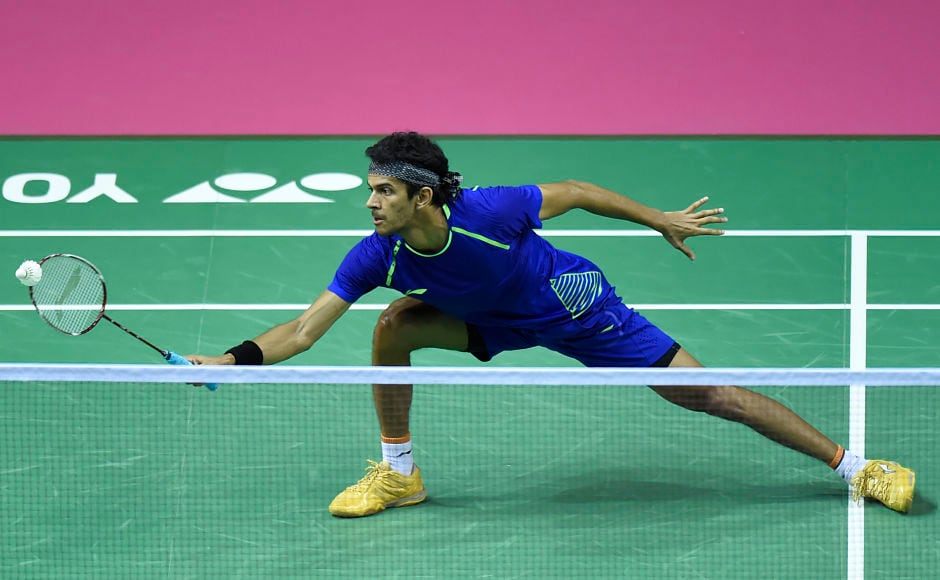 India's Ajay Jayaram returns against China's Chen Long during their round three men's singles match during the 2017 BWF World Championships of badminton at Emirates Arena in Glasgow on August 24, 2017. / AFP PHOTO / ANDY BUCHANAN