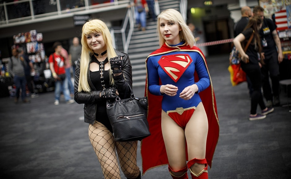 Two cosplayers dressed as Blackcat and Supergirl attend London Super Comic Convention at Business Design Centre in Islington, London on 26 August, 2017. AFP PHOTO