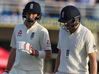 Joe Root (L) and England's Dawid Malan leave the field at close of play on the third day. AFP