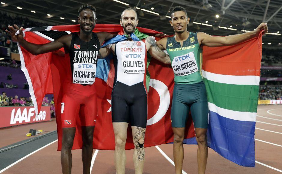 Gold medal winner Ramil Guliyev (centre) celebrates with silver medal winner Trinidad and Tobago's Jereem Richards (left) and bronze medal winner South Africa's Wayde van Niekerk (right). AP