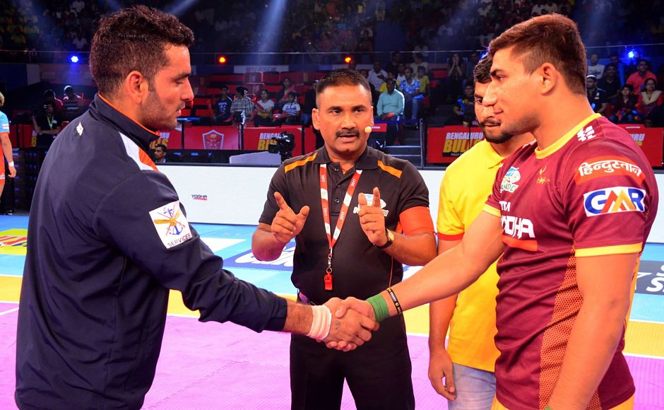 Captains Nitin Tomar (UP Yoddhas) and Surjeet Narwal (Patna Pirates) greet each other before the start of the first match Image Courtesy: Facebook page of Pro Kabaddi