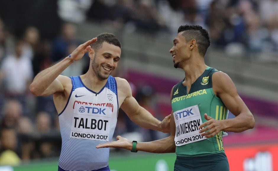 Both Van Niekerk and Talbot were timed at 20.16 seconds, but Van Niekerk finished first by the smallest margin possible. AP