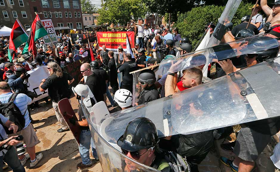The chaos erupted around what is believed to be the largest group of white nationalists to come together in a decade — including neo-Nazis, skinheads, members of the Ku Klux Klan — who descended on the city to