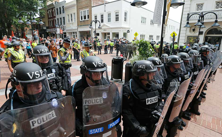 There were street brawls and violent clashes; the governor declared a state of emergency, police in riot gear ordered people out and helicopters circled overhead. AP