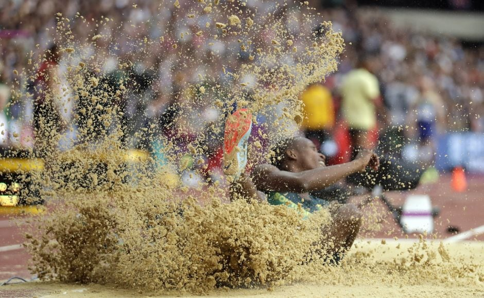 South Africa's Luvo Manyonga, qualified for the long jump final on his first attempt, setting a mark of 8.12 meters, 7 centimeters beyond the automatic qualifying mark. AP