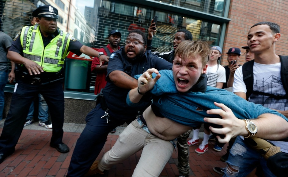Hundreds of police officers on Saturday in Boston tried to deter violence at a 'free speech' rally featuring far-right speakers. AP