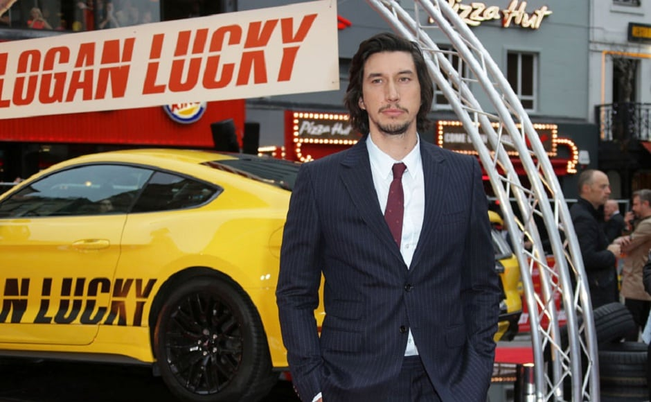 Adam Driver plays Clyde Logan, a West Virginian bartender who has lost one arm to a roadside mine and since then has always been cursing his ancestors for their family's plight. Image via AP.